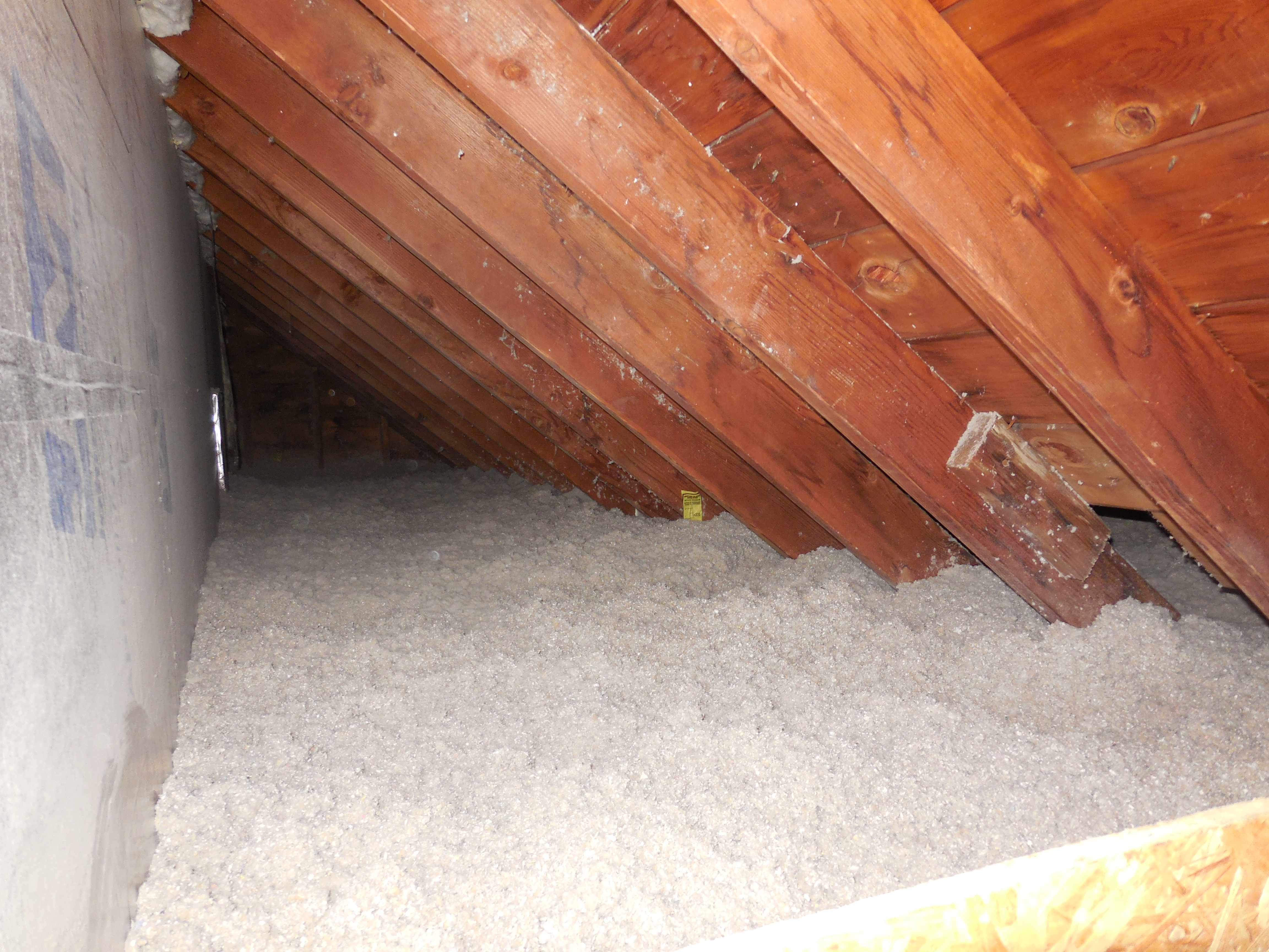 Knee wall attic with over R50 of cellulose insulation installed. & Building Retrofits